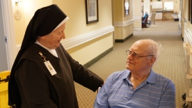Sr. Ann Elizabeth Brown, O.Carm with a resident