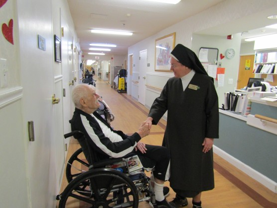 Sr. Julie with a resident